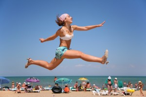 Leaping woman on a beach